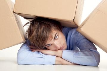 Man under boxes