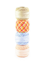 Pyramid of four skeins of yarn