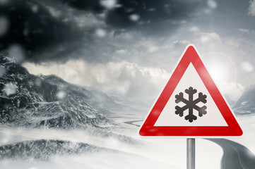 winter driving - snowfall - caution - warning sign
