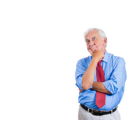 Happy senior mature man daydreaming about something