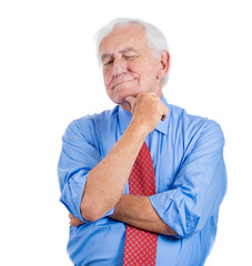 Senior businessman, daydreaming, thinking, trying to remember