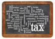 tax  word cloud on blackboard