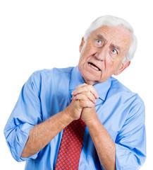 Old man praying, asking for forgiveness
