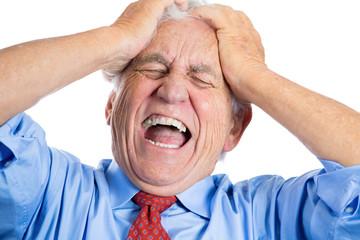 Stressed old man, senior executive having terrible headache
