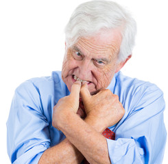 Stressed worried old man, anxiously biting fingernails