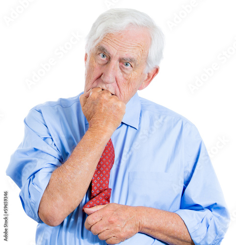 Scared, anxious old man biting his finger nails