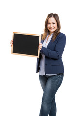 Business woman holding a shalkboard
