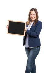 Business woman holding a shalkboard