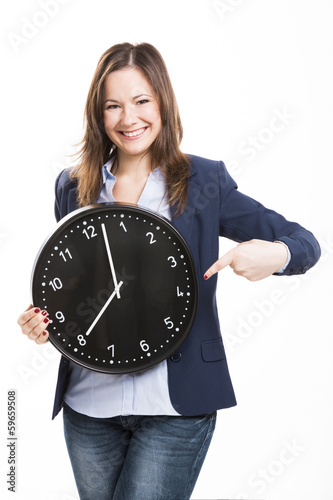 Business woman holding a big clock