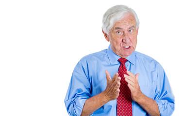 Old male executive having unpleasant conversation