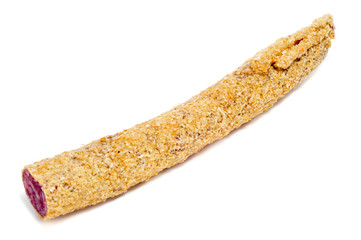 fuet, a spanish sausage, coated with onion