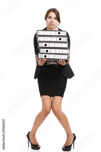Beautiful woman carrying folders