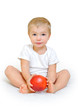 little boy  with a big red apple on a white background