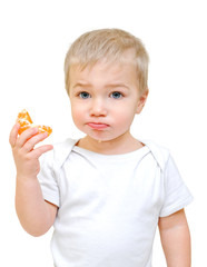 little boy with tangerines on a white background