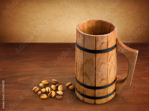 wooden mug on wooden background