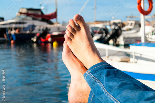 Male feet against sea