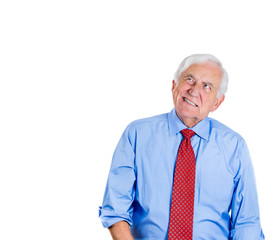 Unhappy, stressed, grumpy old man looking up, loud noise