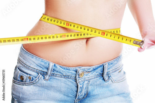 female measuring her waist
