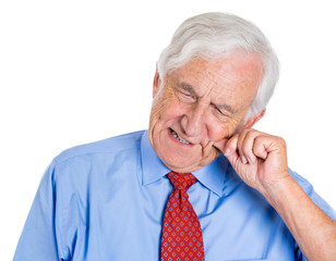 Old, sad man in pain, having a bad tooth ache