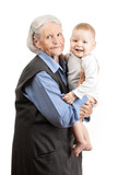 Portrait of a senior grandmother holding grandson over white