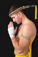 Martial arts praying thai boxer