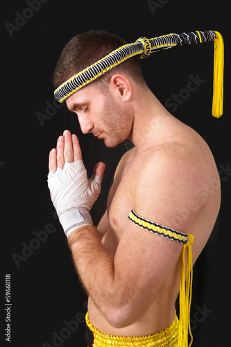 Martial arts praying thai boxer