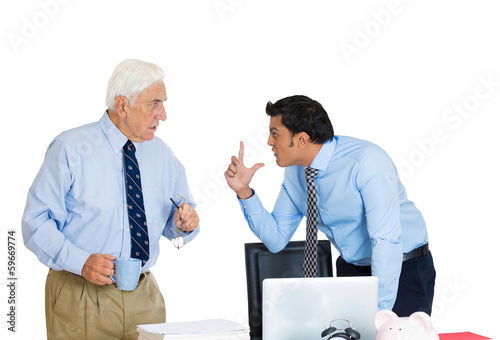 Conflict at work. Two business men fighting in office