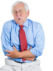 Old man, elderly executive doubling over in stomach pain