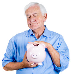 Old man holding, petting piggy bank. Financial decisions