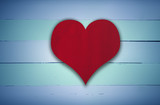 Red heart sign on blue and green retro wooden panel background