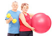 Mature man and woman posing with exercising equipment