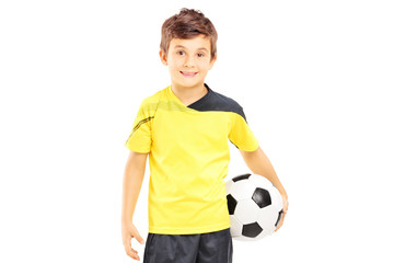Kid in sportswear holding a soccer ball