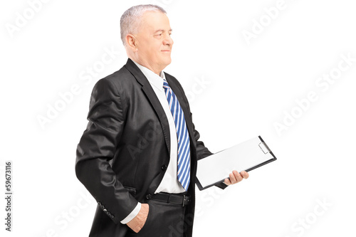 Mature businessman posing with clipboard