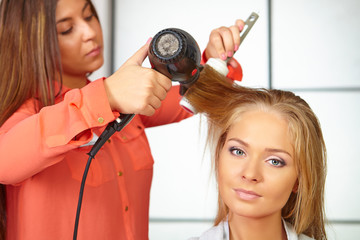 Hair salon. Womens haircut. Use of hair dryer.