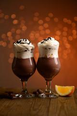 Tasty dessert with chocolate, cream and orange sauce,