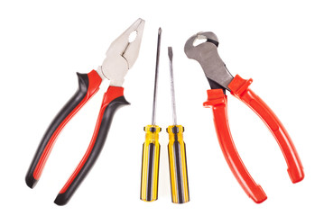 Pliers, screwdrivers and nippers on a white background