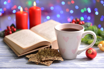 Composition of book with cup of coffee and Christmas