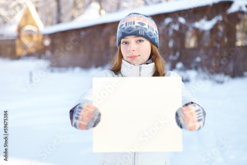 Young woman with blank banner outdoors. Winter.