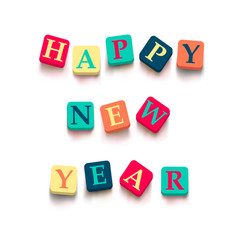 "Words ""happy new year"" with colorful blocks"