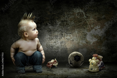 Baby boy around their toys looking at the image on the grunge wa