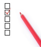 Checklist and red pencil closeup
