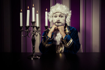 Vintage, man dressed in rococo style, concept of wealth and pove