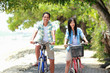 man and woman having fun riding bicycle together
