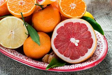 Fresh citrus fruits on rustic background