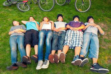 Resting teenagers  after bicycle ride