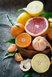 Fresh citrus fruits on rustic background