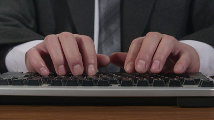 Business man typing on keyboard