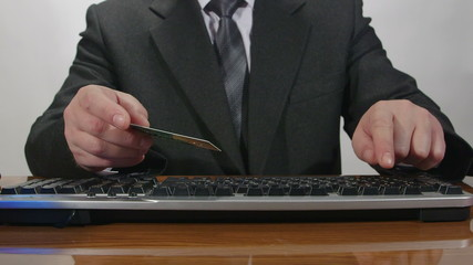 Businessman using credit card for online transaction