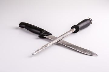 Knife and whetstone isolated on white background