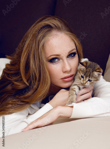 beautiful girl with red hair with little kitty